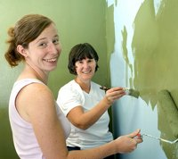 Mother and teen painting a bedroom