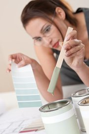 woman smelling a low voc paint